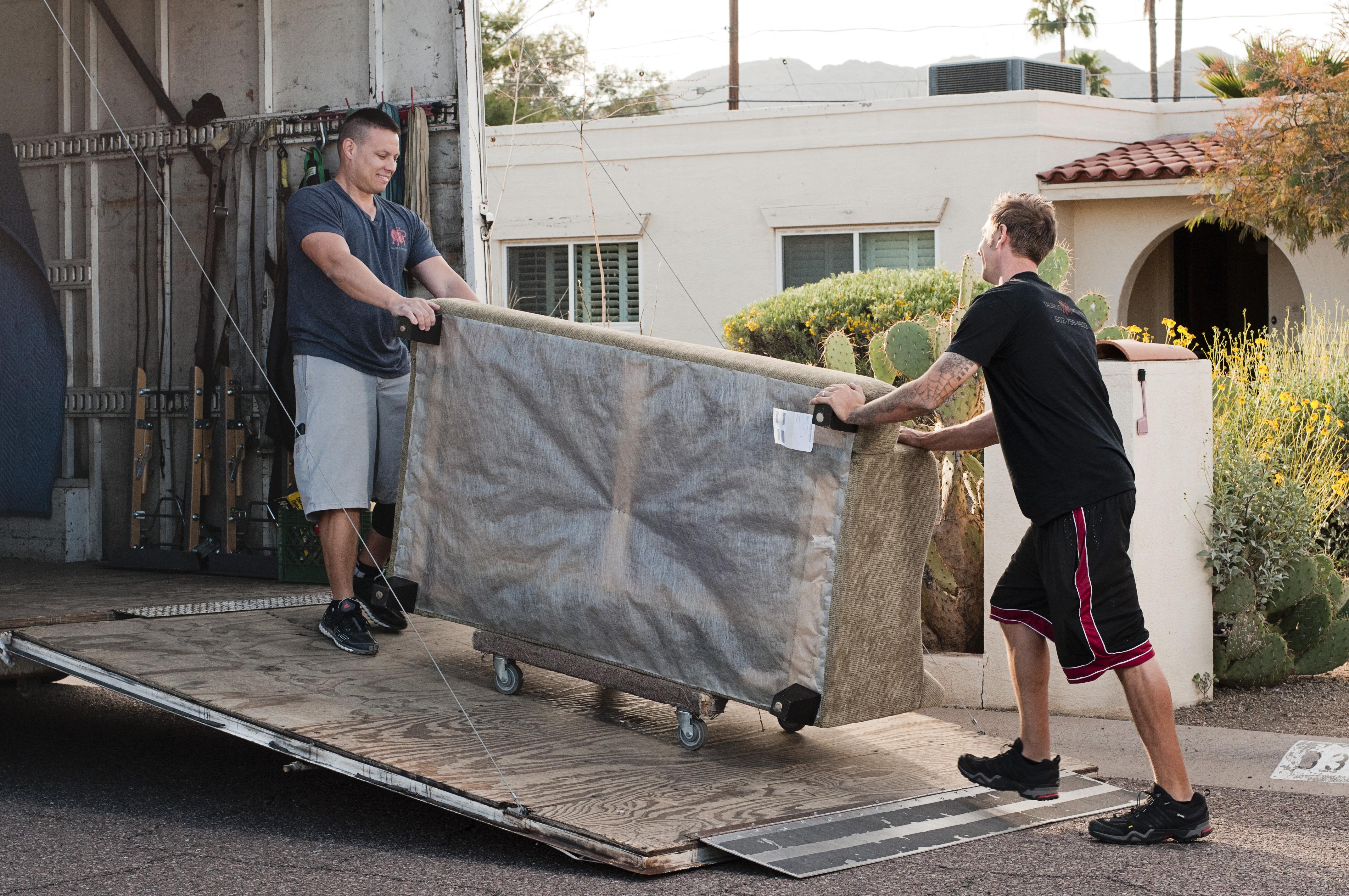 men moving box
